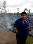 Kelly Hudson stand in front of Pu'u O'o lava flow