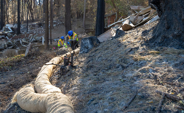 CCC crews install wattles in a burn scarred area of Berry Creek