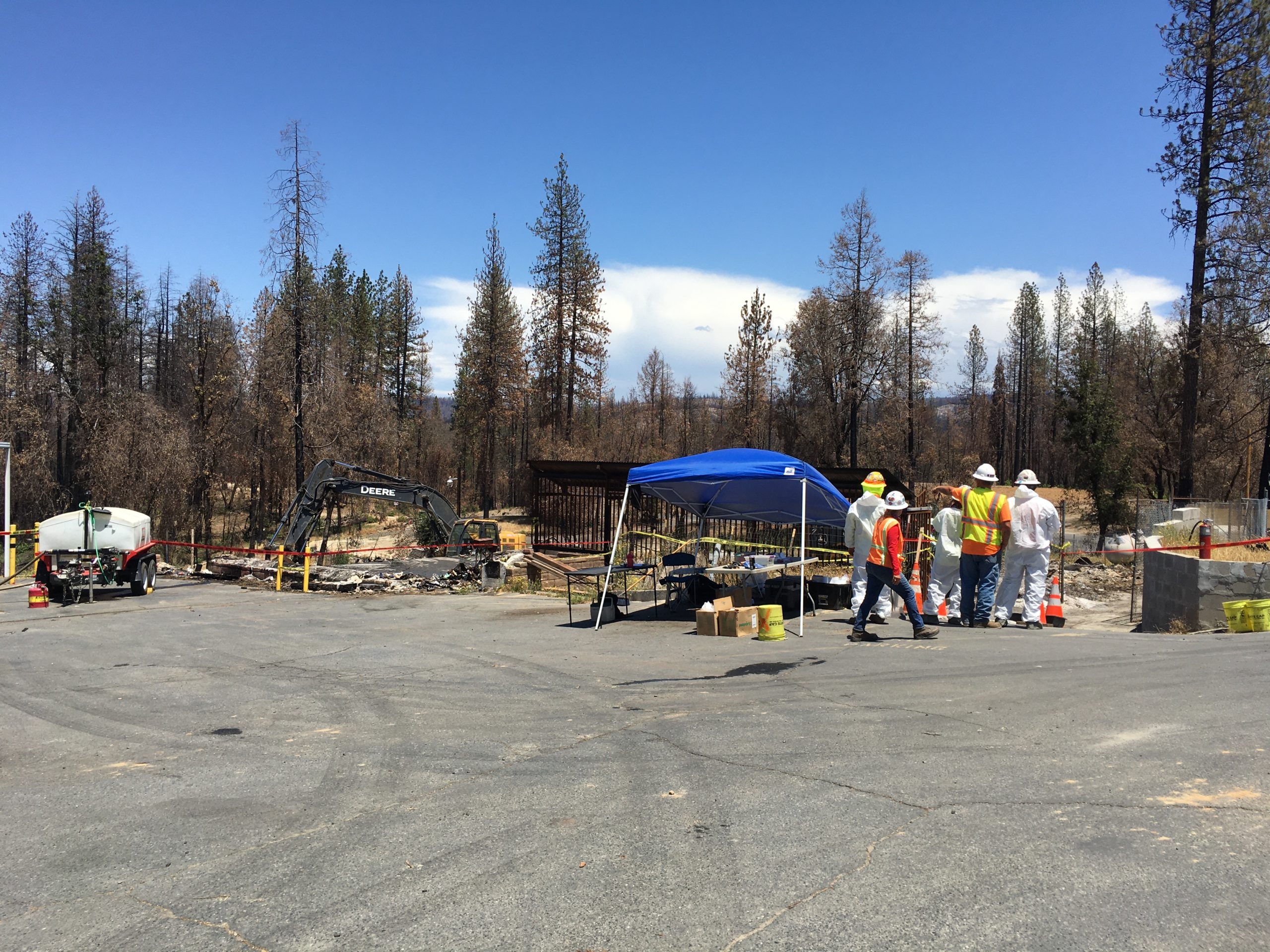 Debris removal team looks at site of structure fire