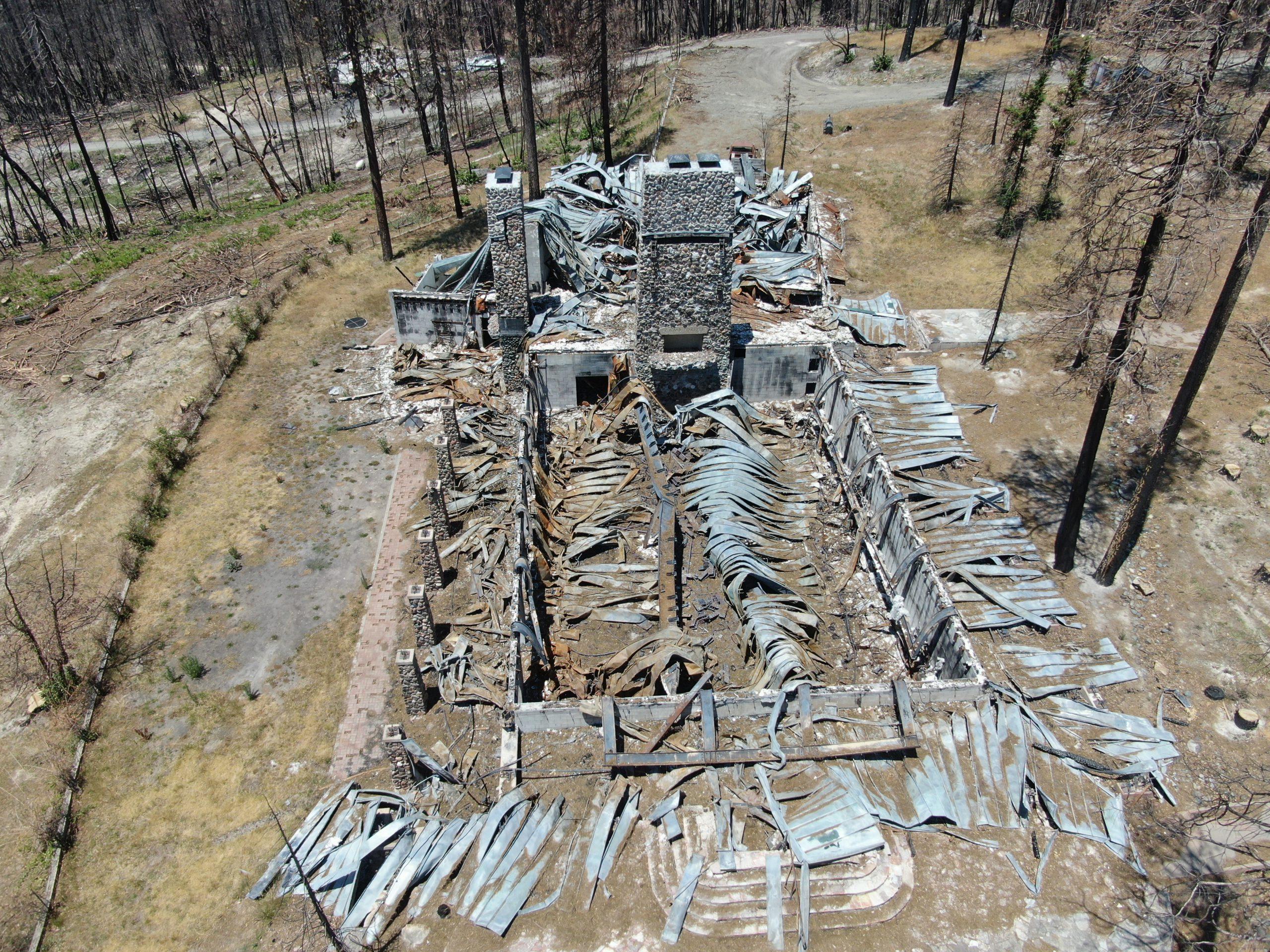 Burned structural debris at Camp Okizu