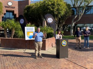 Christina Curry from Cal OES, standing at podium